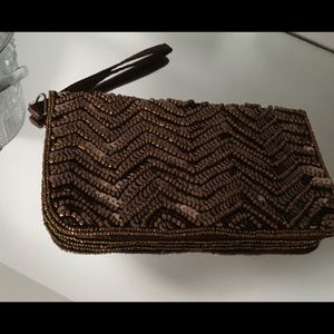 Sequin clutch brown tone , satin lined